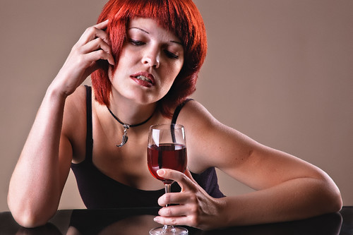 girl c a red wine glass