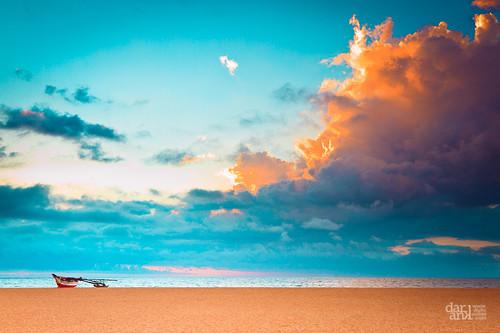 ocean blue light sunset sea sky brown beach water clouds canon boat sand horizon 7d srilanka 24105mm negambo