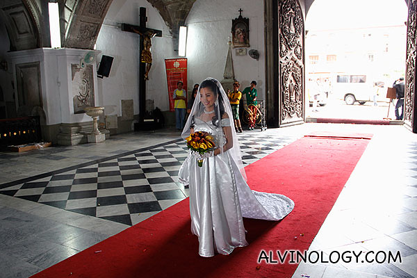 The radiant bride slowly making her way in