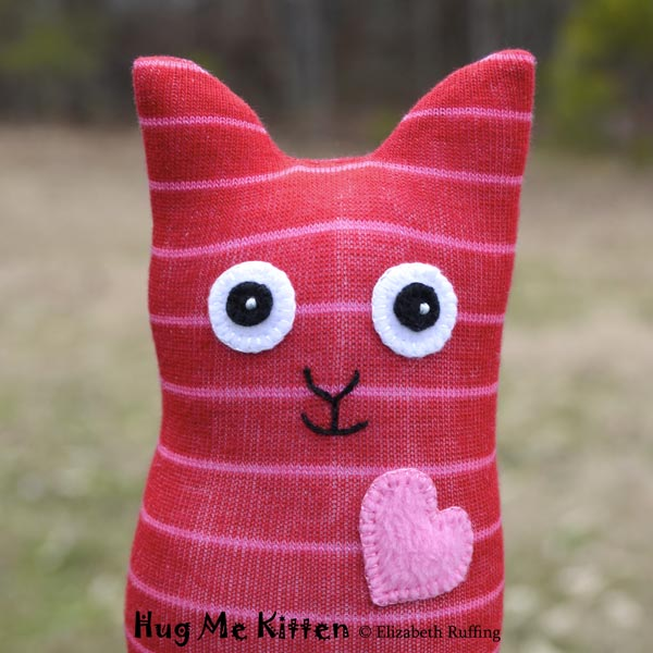 Red-and-pink striped Hug Me Sock Kitten, original art toy by Elizabeth Ruffing