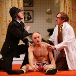 Roderick Hill as Nicholas Beckett' John Seidman as Sergeant Match' and Tim Donoghue as Dr. Prentice in the Huntington Theatre Company's production of