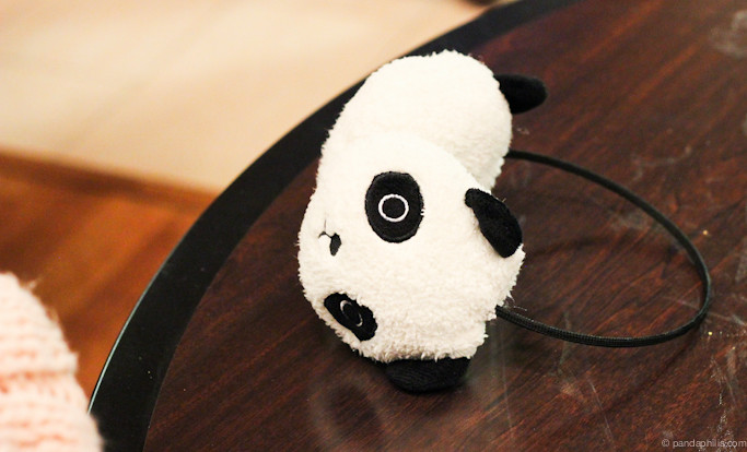 still life: panda earmuffs on a dirty table