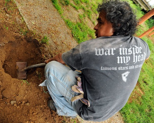 war inside my head, t-shirt, Tito digging a hole, gloves, shovel, Seattle, Washington, USA by Wonderlane