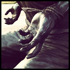 hands from the POW memorial