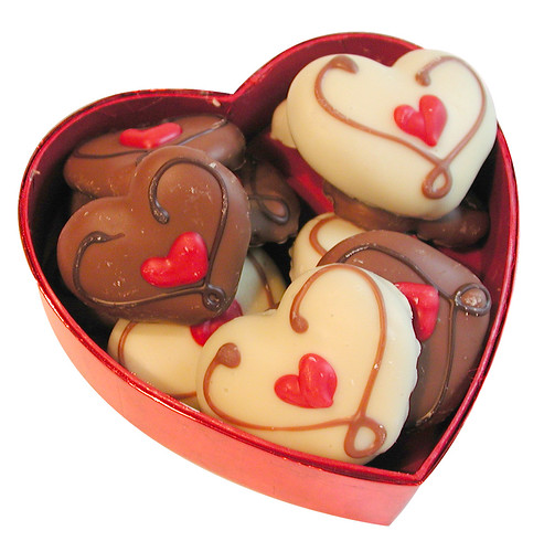 A heart-shaped box filled with chocolate-shaped hearts