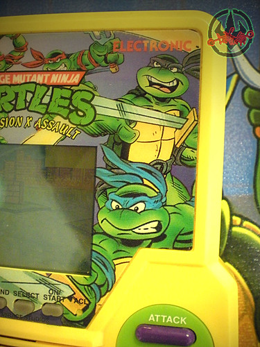 "TIGER ELECTRONICS :: ""TEENAGE MUTANT NINJA TURTLES: DIMENSION-X ASSAULT"" 'TALKING' ELECTRONIC LCD GAME x (( 1995 ))"