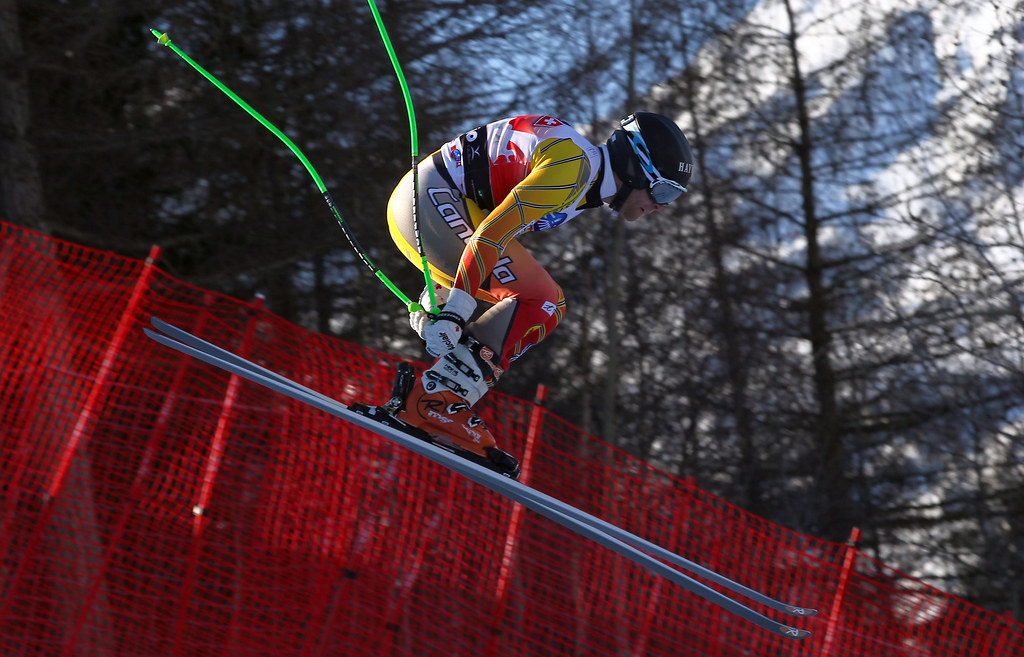 Robbie Dixon flies through the air in a downhill training run in Bormio, Italy.