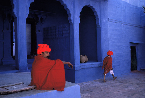India. Jodhpur. Two men in bright red traditional dress on the blue streets of Jodhpur. 1996.
