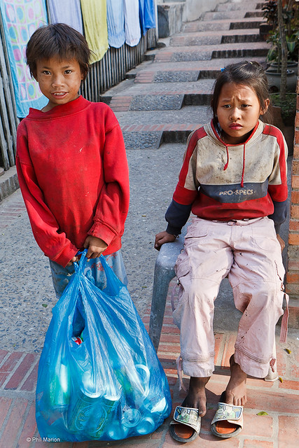Working children collecting recyclables - Luang Prabang