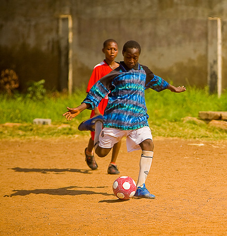Children playing football in Ghana