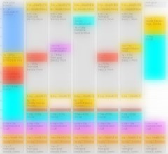 Blurred view of a color-coded calendar for one week