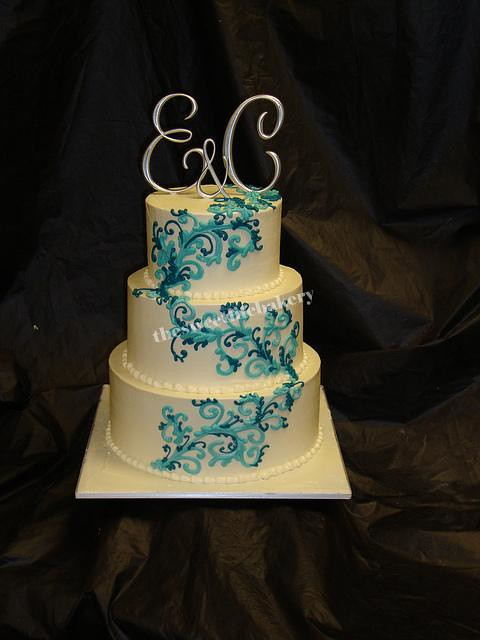 Teal and Blue Swirl Wedding Cake Light teal swirls accented with a dark