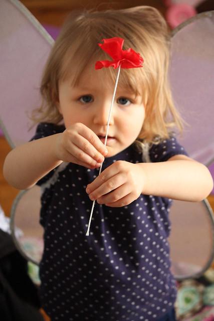 c holding flower