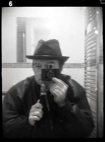 reflected self portrait with Baby Ikonta camera and leather hat by pho-Tony