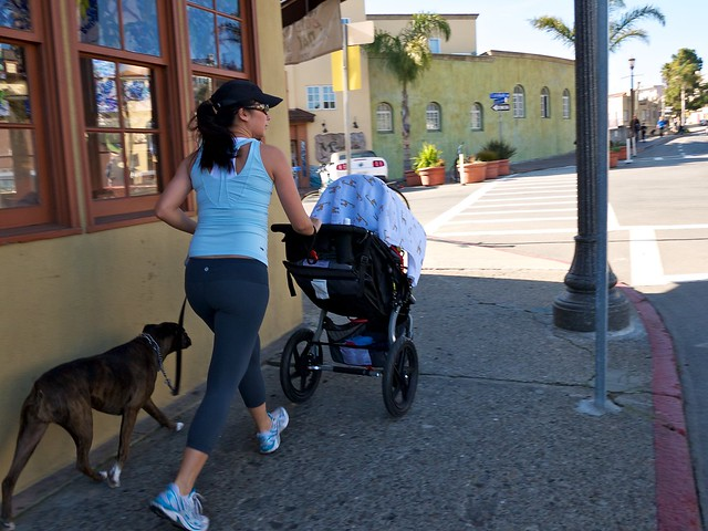 Jogging with Dog and Baby by Capitola Wharf