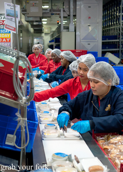 Assembly line for Economy Class trays during a behind-the-scenes tour of Emirates Flight Catering