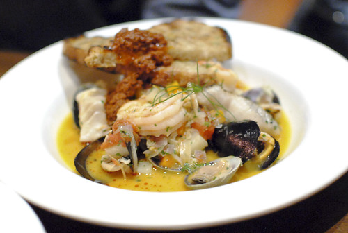 Pacific seafood soup grilled bass, Dungeness crab, mussels, clams, white shrimp & romesco