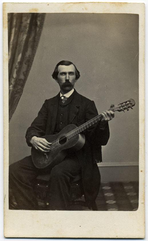 A Gent Picks At His Guitar