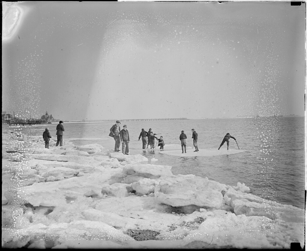Boys riding ice cakes in Dorchester Bay