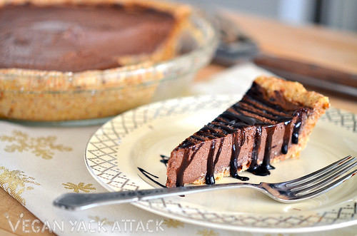 Slice of raw chocolate mousse pie on a plate with a fork