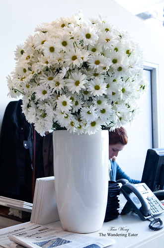 Large daisy centerpiece at the hostess stand
