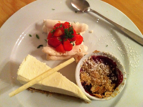 Trio of Desserts: White chocolate cheesecake; Mixed berry crumble; Meringue tower of strawberries & vanilla cream