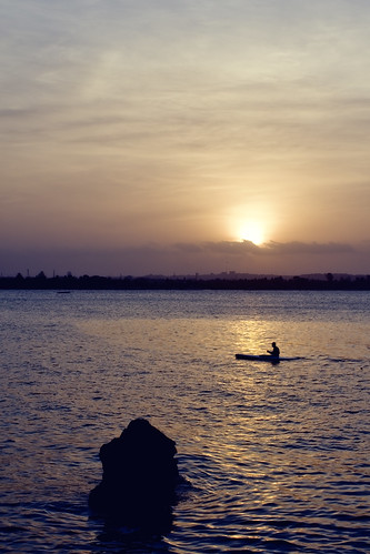 africa sunset man water skyline mall river tanzania evening daressalaam canoe slipway pentaxk5 pentaxfa43mm119limited