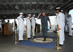 POLARIS POINT, Guam (Nov. 30, 2011) Sideboys render honors to Rear Adm. Glenn Robillard, U.S. Pacific Fleet's deputy chief of staff for logistics, as he crosses the quarterdeck of the submarine tender USS Frank Cable (AS 40). (Navy photo by Mass Communication Specialist 3rd Class Corey Hensley)