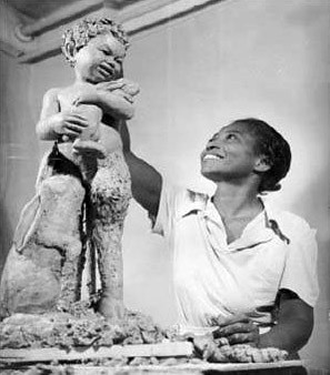 photo of Augusta Savage working on a sculpture