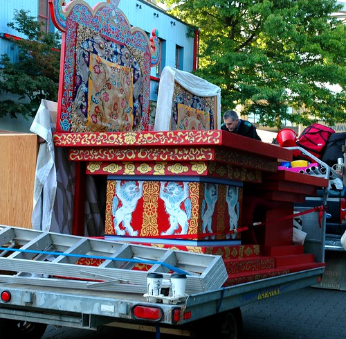 Coffee cups, transporting the lama's thrones, snow lions standing, gold dharmachakra, painting, ladder, khatas, silks, buckets, supplies, picking up live crabs for the Life Release Project, Centennial of Dilgo Khyentse Rinpoche, Vancouver, Canada by Wonderlane