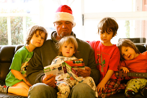 Dad with the kids on Christmas morning