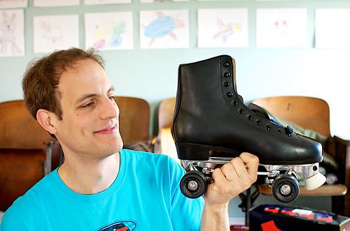 Mark examining his rollerskates.