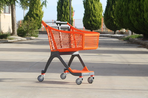 Shopping trolley with lower tray.
