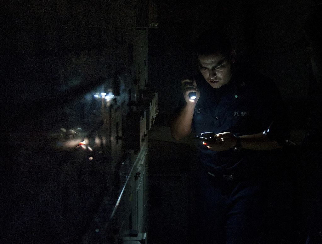 Electrician's Mate 3rd Class Juan Murillo reports the status of an electrical load center.