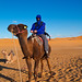 My dad on a camel in the Dessert by kokkiesjoe