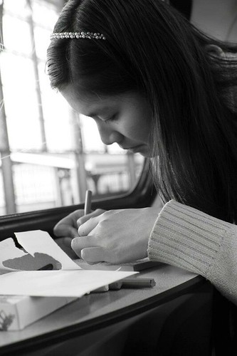 a girl writing something
