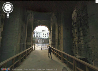 Lone_man_in_The_Colosseum,_Rome