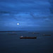 Boats and moonlight at Bahia de Todos os Santos by Carlos Ebert