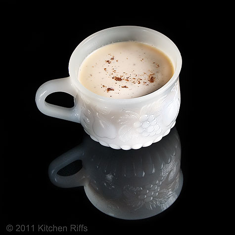 Eggnog in white punch cup on black acrylic