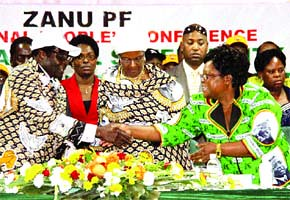 Republic of Zimbabwe Vice-President Joice Mujuru congratulates President Robert Mugabe on his concluding speech at the ZANU-PF 12th National People's Conference held in Bulawayo in early December 2011. The party stands poised for the elections. by Pan-African News Wire File Photos