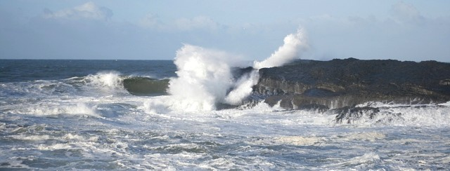 waves breaking on rocks sligo