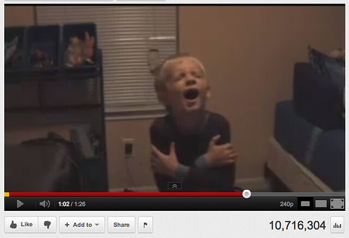 screen shot of the YouTube video--a young white boy with blond hair is dancing alone in his room