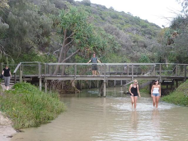 John posing on the wooden bridge at the start of the stream