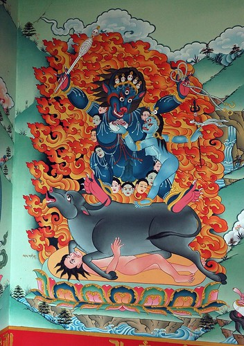 Yamāntaka riding an ox (Sanskrit: यमान्तक Yamāntaka; Tibetan: Shinjeshe, གཤིན་རྗེ་གཤེད་, རྡོ་རྗེ་འཇིགས་བྱེད།, gshin rje gshed; rdo rje 'jigs byed) a Mahayana Yidam, holding skeleton wand and noose, consort, flames of wisdom, wall mural, Pharping,  Nepal by Wonderlane