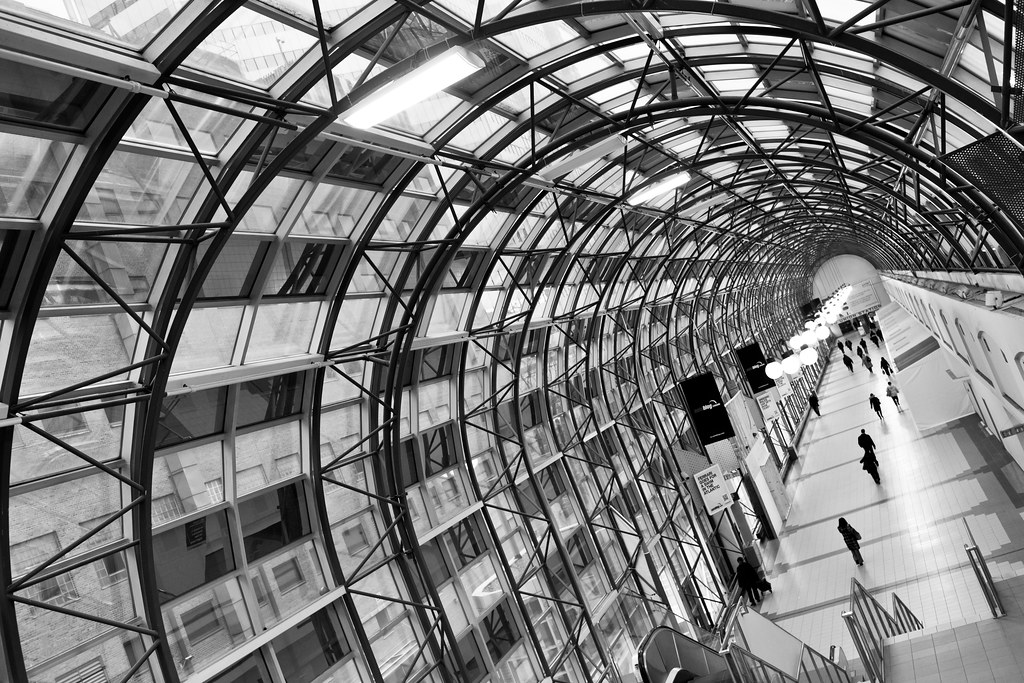 black and white inside the skywalk near union station in toronto
