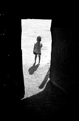 boy in door by Joshua Zakary