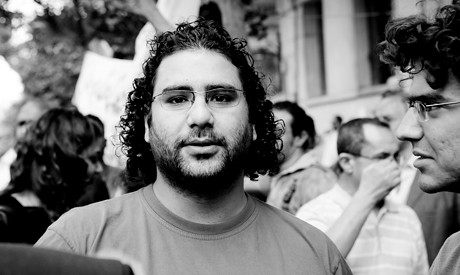 Egyptian blogger Alaa Abdel-Fattah trial date set for March 23, 2014. He has been held in detention since November 2013. by Pan-African News Wire File Photos