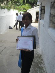 New graduate showing off her diploma