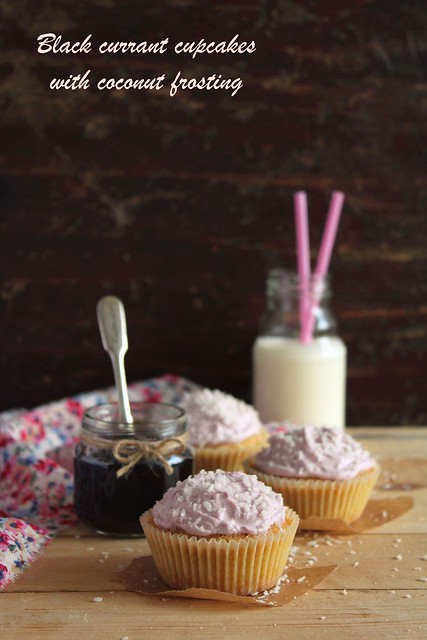 Black currant cupcakes with coconut frosting