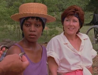 Alfre Woodard and Mary McDonnell in the film Passion Fish. They are sitting outside.
